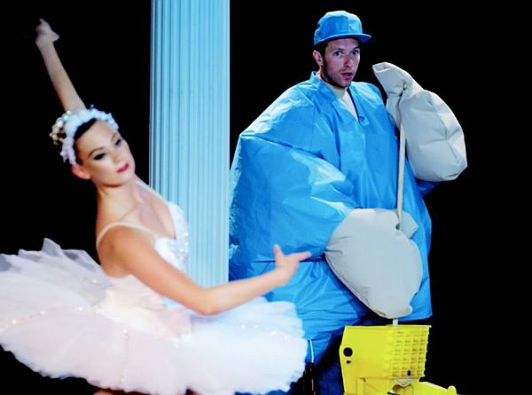 Watch Chris Martin and Jessica Lucas Dance in Sumo Suits in Coldplay's 'True Love' Music Video