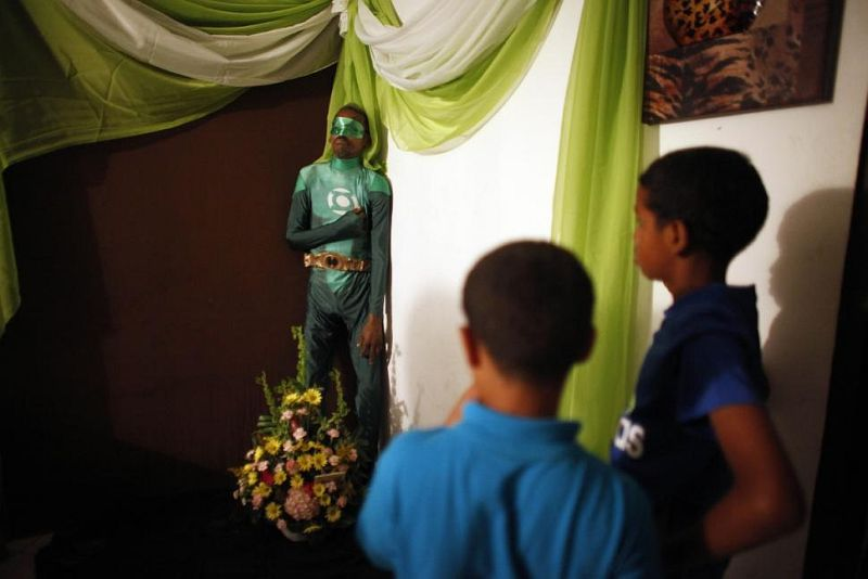 A Dead Puerto Rican Man Was Dressed As Green Lantern And Propped Upright for His Wake
